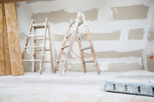 Two ladders in an attic to be renovated