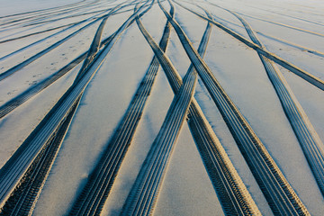 Tire tracks on the soft surface of sand on a beach. ,Long Beach Peninsula