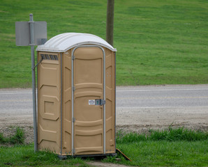 Portapotty on empty roadside