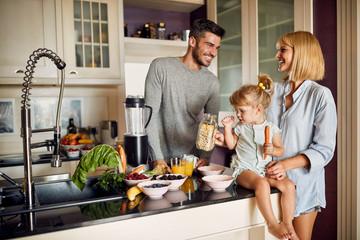 Happy family preparing healthy breakfast