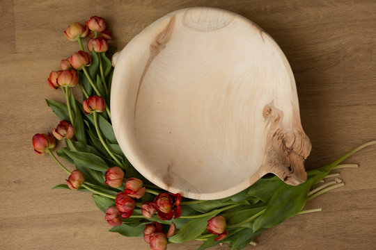 tub of wood decorated with tulips. basket for newborn photo shoot