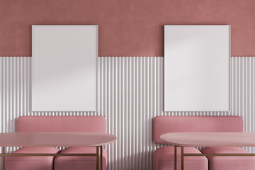 Interior of bright pink restaurant with posters