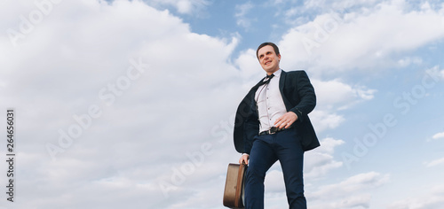 A Young Smiling Male Businessman With A Good Mood In A Dark