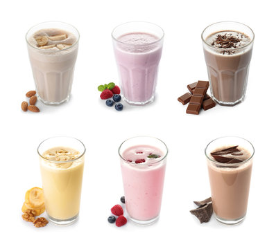 Set of glasses with delicious protein shakes on white background