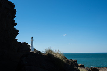 Castlepoint Lighthouse in the Wairarapa, New Zealand on a clear sunny day