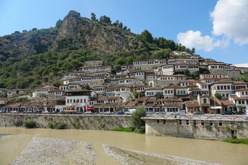 Murky river running past idyllic downtown of an ancient Ottoman city in Albania