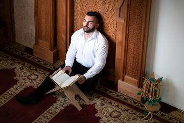 Muslim Man Reading Holy Islamic Book Koran