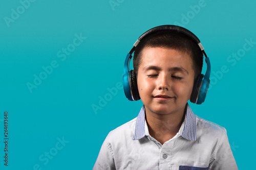 Young Boy With Closed Eyes And Smiling Happy Wearing