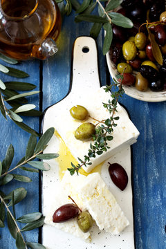 Greek cheese and olives on wooden table