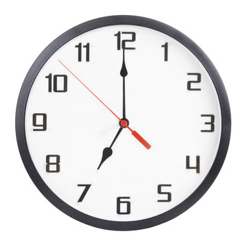 Wall clock isolated on white background. 7 p.m. or 7 a.m.