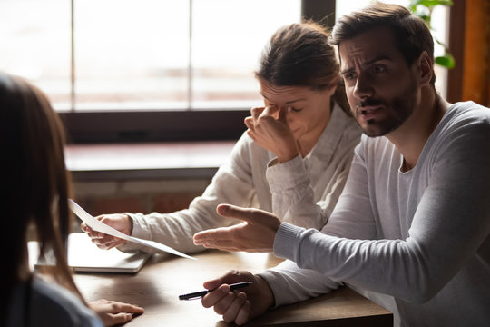 Indignant millennial male accusing incompetent female colleague
