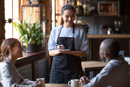 Waitress welcoming restaurant guests take order writing on notepad