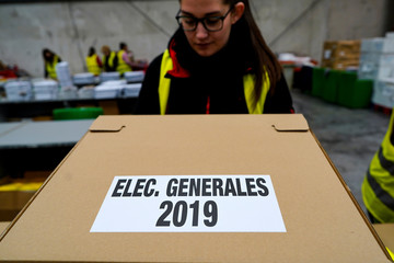 Worker moves boxes containing ballots before Spanish general election in Alcala de Henares