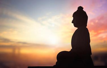 Buddhist concept: Vesak day Silhouette Buddha with blurred travel