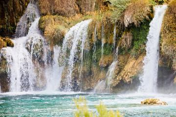Krka, Sibenik, Croatia - Watrefall spume spraying into a cascade at Krka National Park