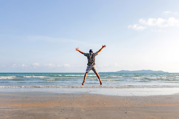 happy man freedom jump ocean sea scape background