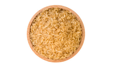 brown rice in wooden bowl isolated on white background. nutrition. food ingredient.top view.