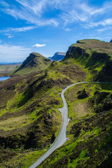 Scenic view of the Quiraing pass, Isle Of Skye, Scottish highlands, Europe. Tourist popular hiking spot, or attraction/destination in Scotland. Beautiful green natural landscape in summer holiday.