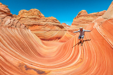 Man surfing the wave in the Arizona desert, USA.