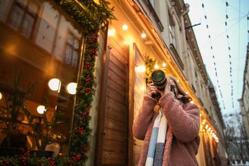 Female photographer outdoors on Christmas eve