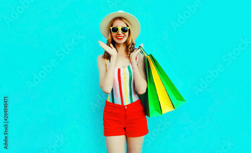 9652874e Portrait happy pretty smiling woman with shopping bags in colorful t-shirt,  summer round