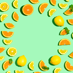 Wall Mural - Round frame of oranges and lemons overhead view flat lay