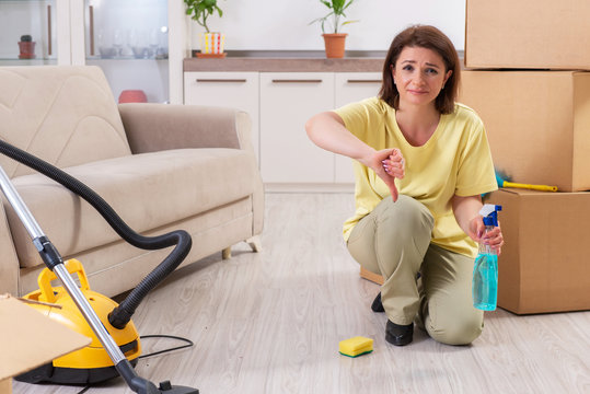 Middle-aged woman cleaning new apartment
