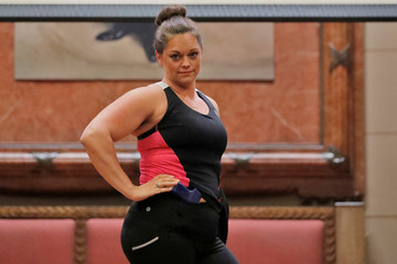 """A woman models Alexo Athletica yoga pants during the """"Fashion & Firearms"""" concealed carry fashion show at the National Rifle Association (NRA) annual meeting in Indianapolis, Indiana"""