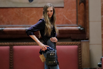 """A woman models a Sportsman bag by Ukoalabag during the """"Fashion & Firearms"""" concealed carry fashion show at the National Rifle Association (NRA) annual meeting in Indianapolis, Indiana"""