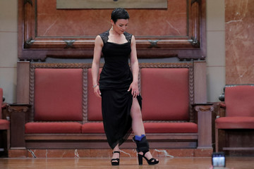 """A woman models the Sticky Holster Ankle Biter Rig by Davenport Guns during the """"Fashion & Firearms"""" concealed carry fashion show at the National Rifle Association (NRA) annual meeting in Indianapolis, Indiana"""