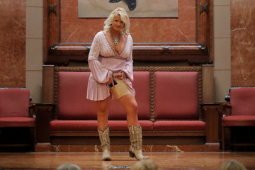 """A woman models a pair of Body Shaping Thigh Holster Shorts by Dene Adams during the """"Fashion & Firearms"""" concealed carry fashion show at the National Rifle Association (NRA) annual meeting in Indianapolis, Indiana"""