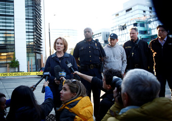 Seattle Mayor Jenny Durkan, left speaks to media near the scene where part of a construction crane fell in a deadly accident on Mercer Street in Seattle