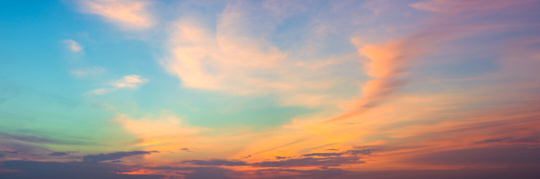 Panoramic beautiful colorful golden hour twilight sky. Beautiful cloud and sky nature background in magic hour. Amazing colorful sky and dramatic sunset evening sky.