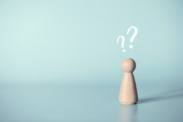 Human with a question mark icon on blue background, copy space.