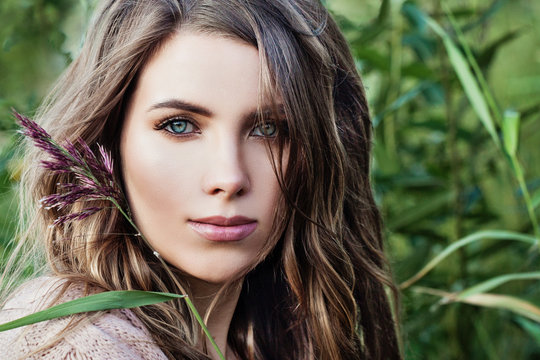 Young beautiful woman on natural green background outdoor