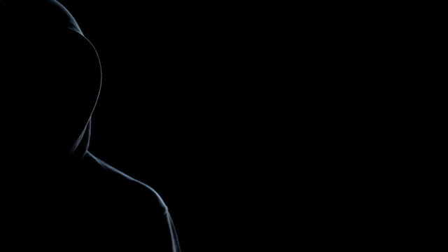 Silhouette of hooded man on black background, template for crime statistic