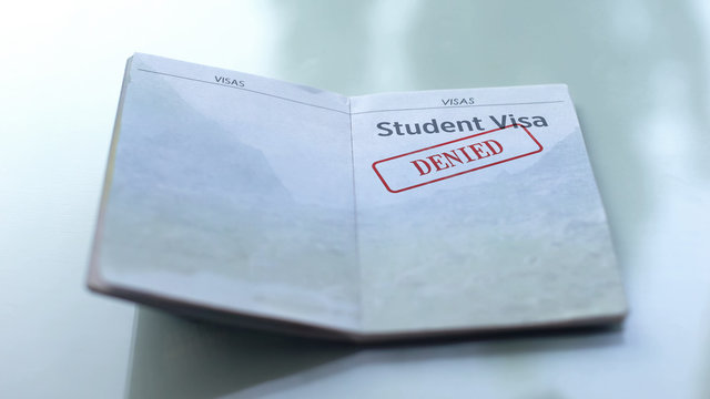 Student visa denied, seal stamped in passport, customs office, travelling