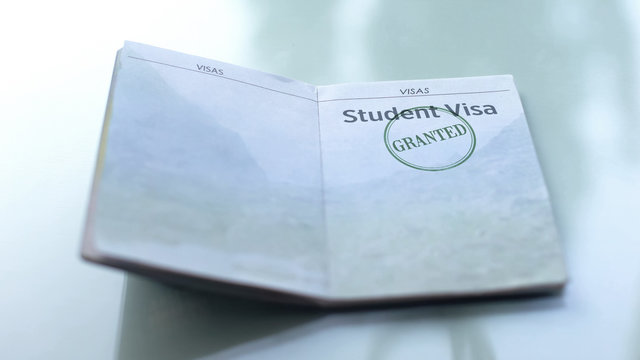 Student visa granted, seal stamped in passport, customs office, travelling