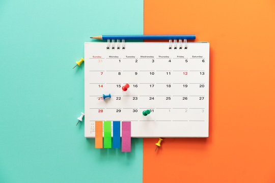 close up of calendar on the table with color background, planning for business meeting or travel planning concept