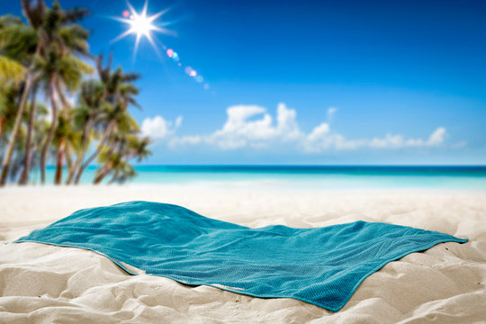 Summer towel on sand and beach background.
