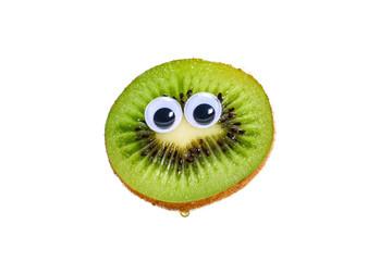 Funny kiwi fruit face with googly toy eyes. Half of fresh ripe whole kiwi fruit isolated on white background. Wall mural
