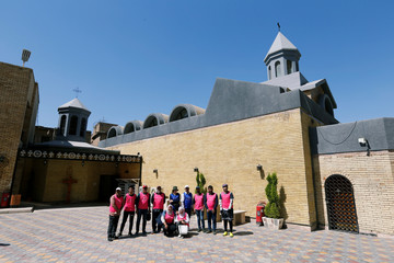 Iraqi cyclists pose for a photo at St. Mary Church during a tour around historic sites in Baghdad