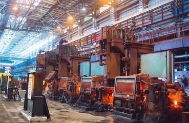 Fototapeta hot steel on conveyor in steel mill