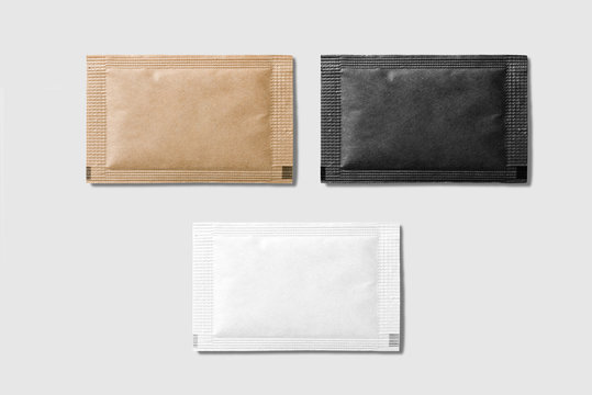 Set of various sugar packet isolated on grey background - High resolution.