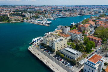 Aerial view of city of Zadar. Summer time in Dalmatia region of Croatia. Coastline and turquoise water and blue sky with clouds. Photo made by drone from above. Fototapete