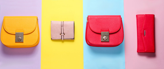 Fashion minimalism.  Bags, leather wallets on pastel paper background. Top view