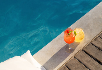 poolside symmetric cocktails served cold at pool bar with signature drink