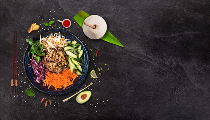 Bun bo nam bo asian food background with various ingredients on rustic stone.