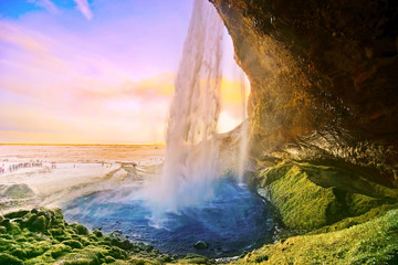View of Seljalandsfoss waterfall at dawn in winter in Iceland.