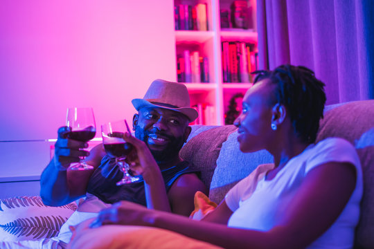 black couple dating with drinking wine romantic dinner at home